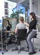 Hairdresser using a Salli Saddle Chair