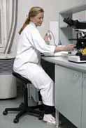 Lab technician using a Salli Saddle Chair