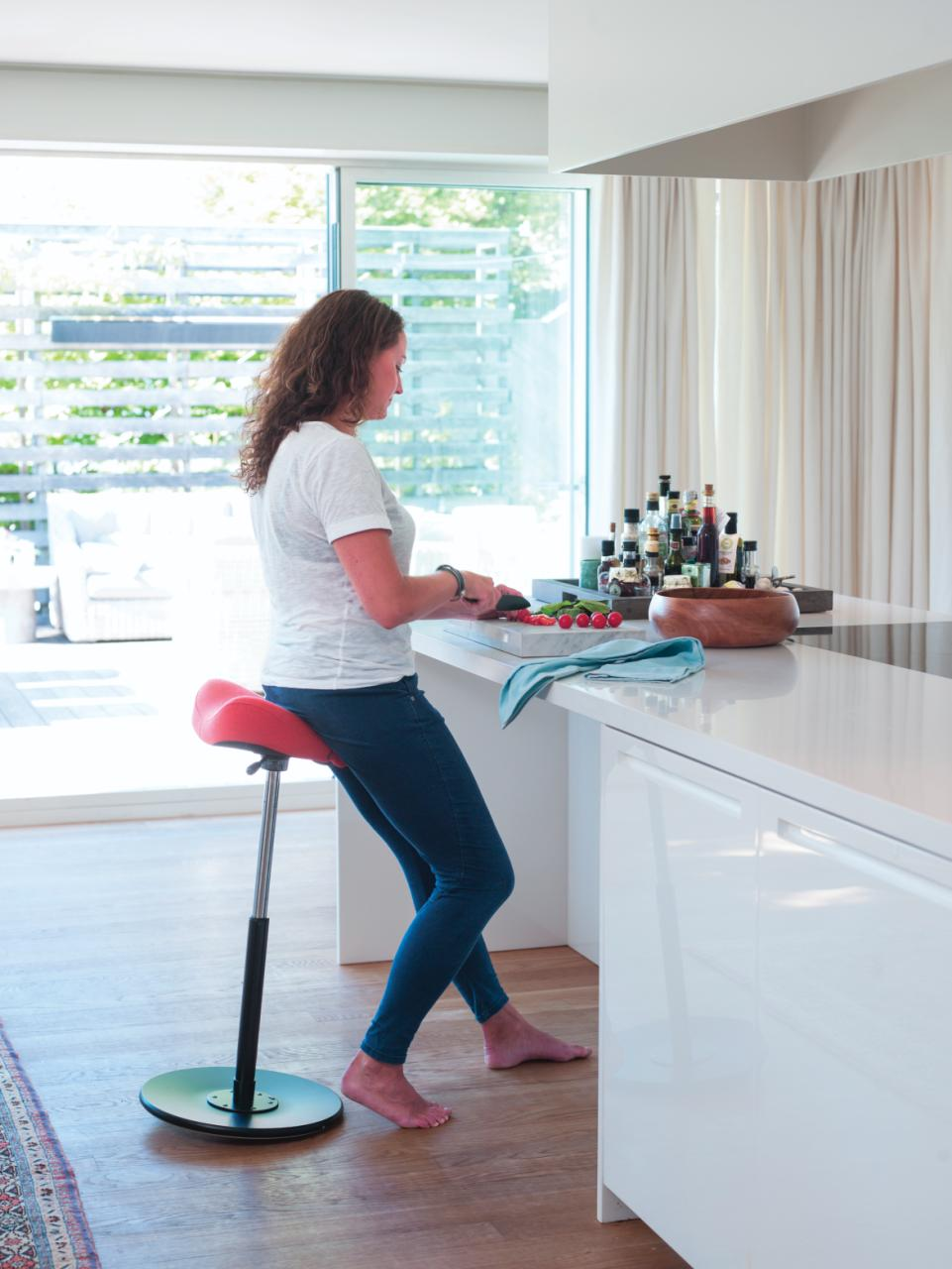 Woman preparing food on a Move Stool